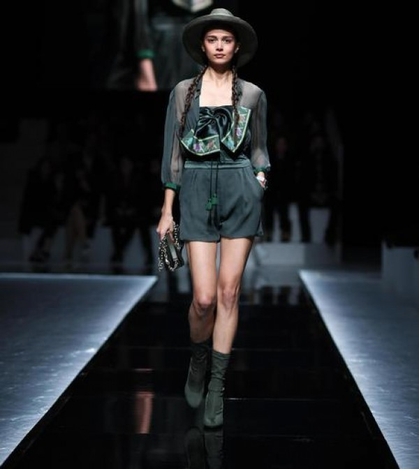 Eccentric touches run through Armani show