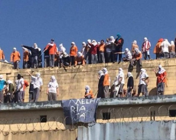 Brazil: decapitated bodies tossed over wall as dozens die in prison drug gang turf war