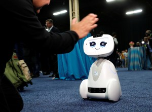 Buddy, an entertainment and assistant robot by Blue Frog Robotics, interacts with a attendee during CES Unveiled at the 2018 CES in Las Vegas, Nevada, U.S. January 7, 2018